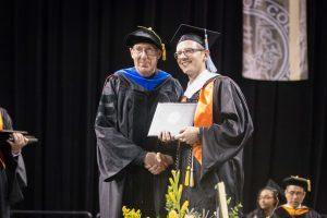 Bradley Plesz receives his master's degree in education.