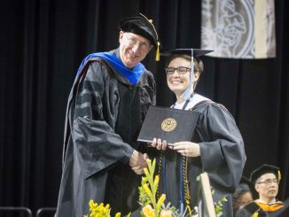 Lauren Rundell receives her master's degree during the 2019 spring commencement