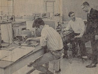 Mark Swan, foreground, in a Gazette Telegraph photo in the electronics lab.