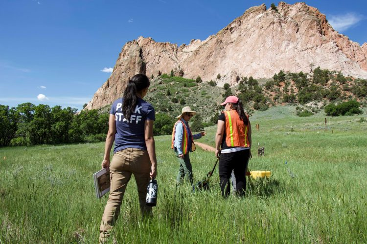 Cordova, Church, and student discuss the possible location of structural remains