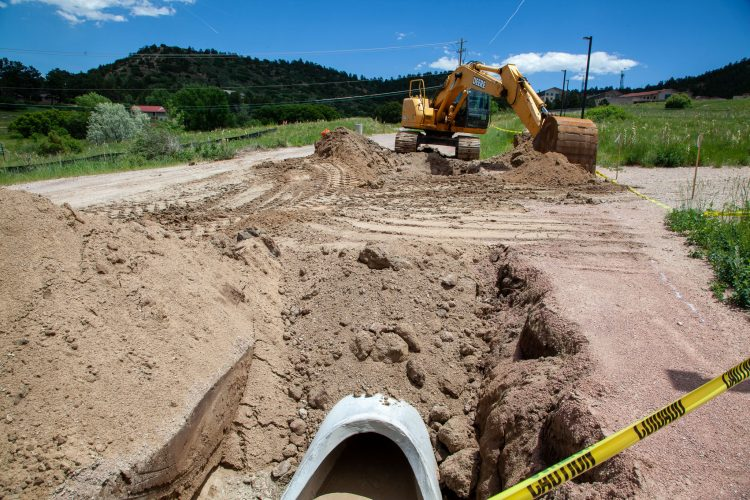 Construction equipment working on stormwater drainage.