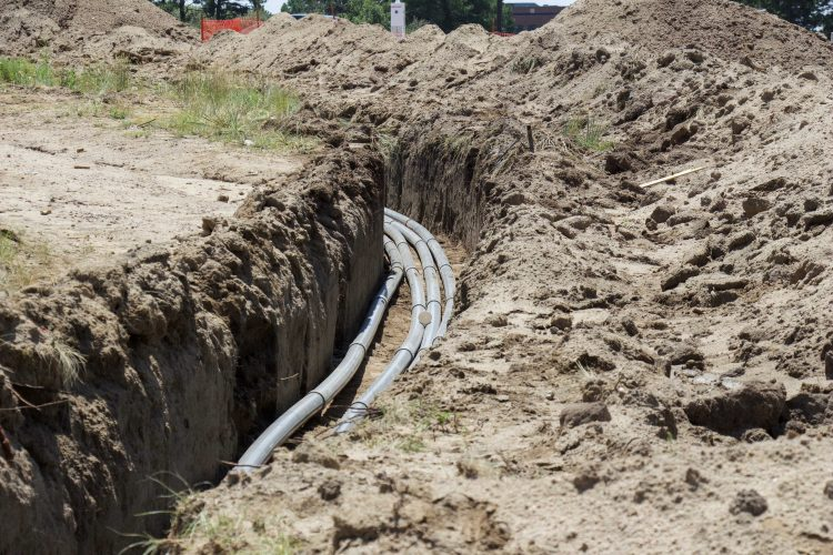 Fiber optic cables are placed to the sides of Spine Road.
