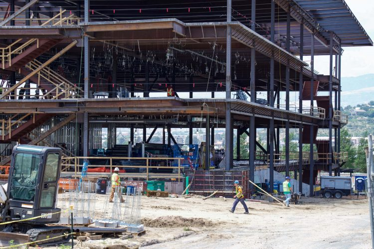 Crews work on the northeast corner and academic entrance of the William J. Hybl Sports Medicine and Performance Center.