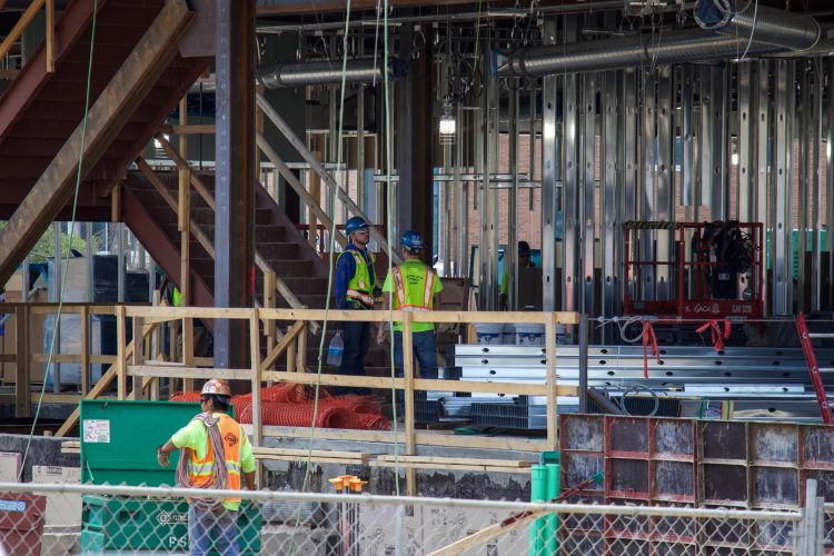 Crews work on the first floor of the William J. Hybl Sports Medicine and Performance Center.
