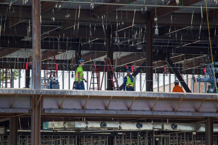 Crews work on the second floor of the William J. Hybl Sports Medicine and Performance Center.