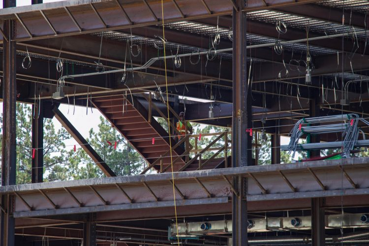 Crews work on the southeast corner of the William J. Hybl Sports Medicine and Performance Center.