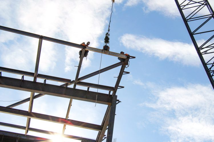 Crews install structural steel on the Hybl Center.