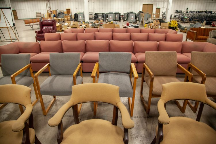A variety of chairs and couches available at the surplus sale