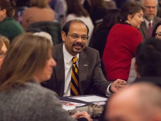 Chancellor Reddy participates in a roundtable discussion.