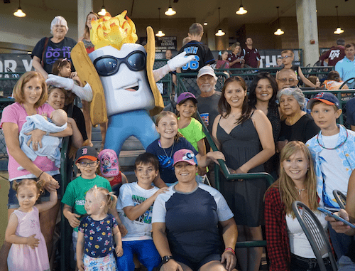 Alumni with Toasty, the Rocky Mountain Vibes mascot.