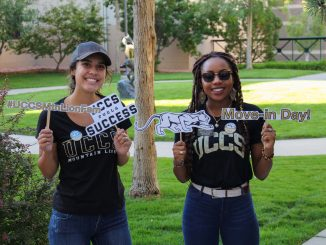 Two former students pose during move-in day 2019
