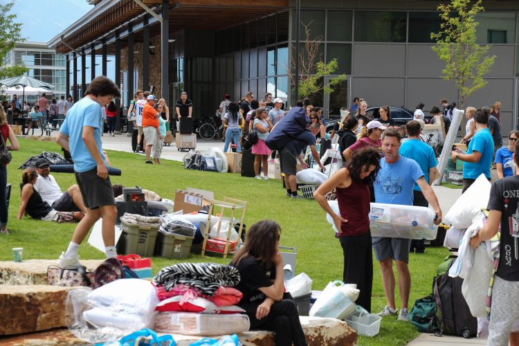 Families waiting with student's belongings in front of residence halls at the Village at Alpine Valley.