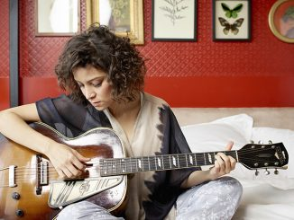 Gaby Moreno holds her guitar