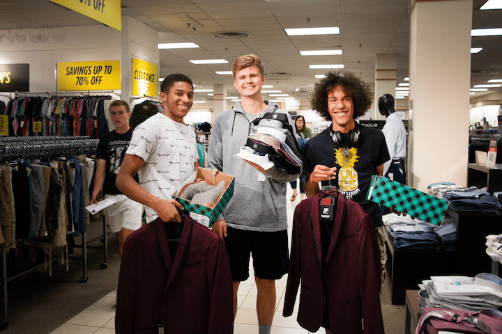 Students picking up clothes at the JCPenney Suit Up event