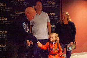 Everett Morgan shakes hands with Scott Kelly.