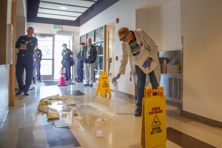 "Firefighters visit campus for a ""spill drill"" in Centennial Hall."