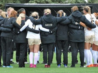 The women's soccer team in a huddle