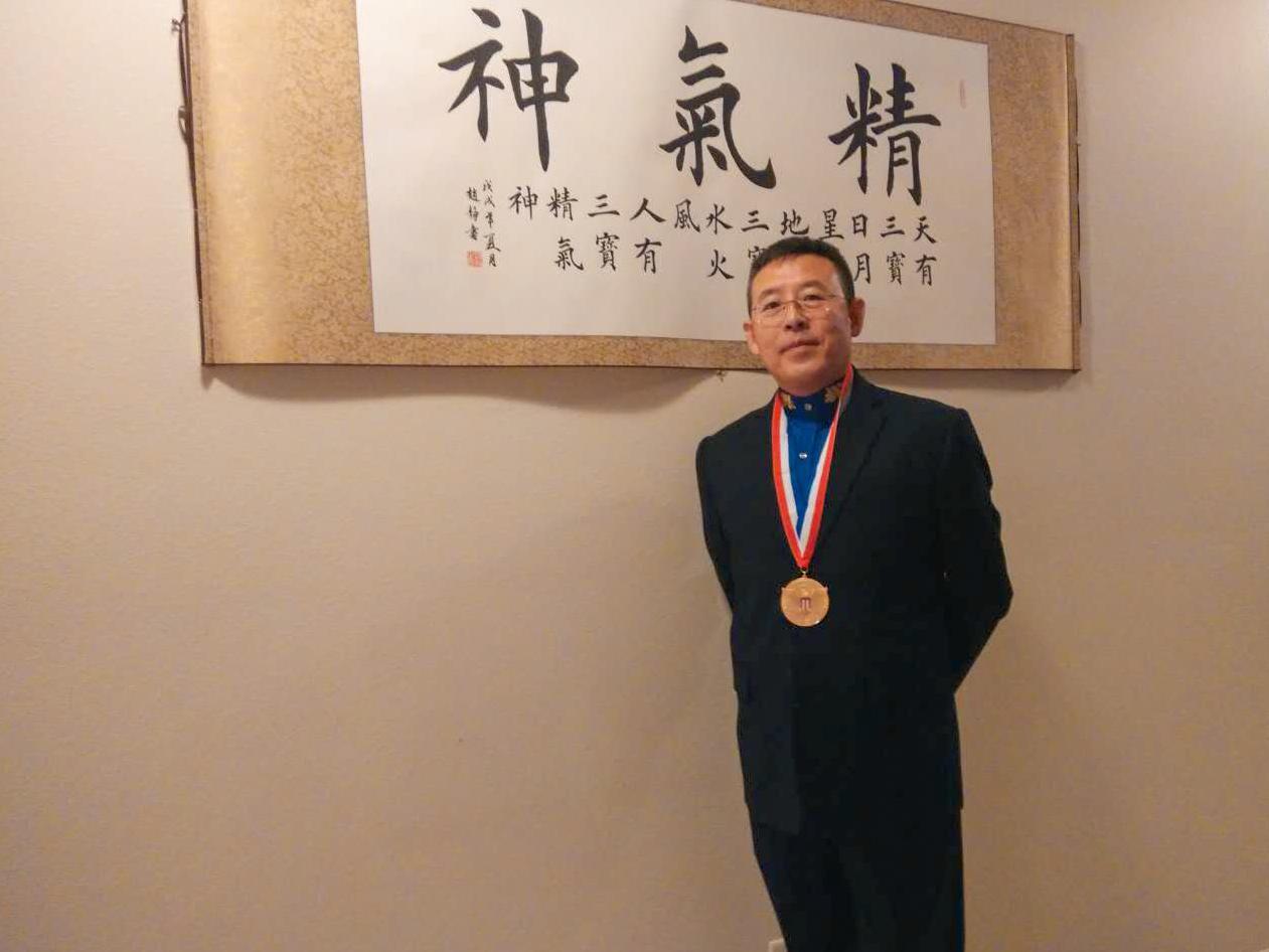 "Jian ""James"" Ma with his President's Volunteer Service Award."