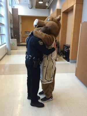 A photo of Clyde hugging a UCCS Police Officer Nov. 28, 2015.