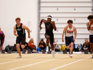 Sprinters in the 60-meter dash at Mountain Lion Fieldhouse