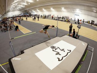 A high jumper competes in Mountain Lion Fieldhouse
