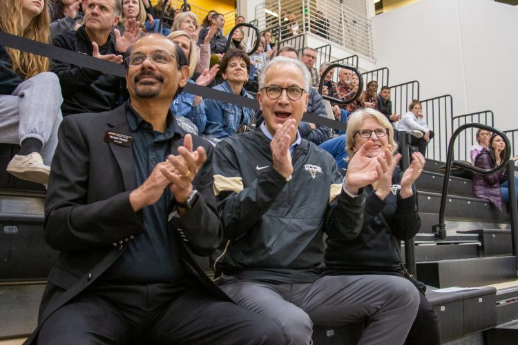 Chancellor Reddy, President Kennedy and First Lady Kennedy cheer on the Mountain Lions