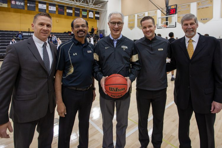 President Kennedy and Chancellor Reddy with athletic director and basketball coaches