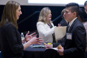 Business students meet with employers during the College of Business Career Networking Night
