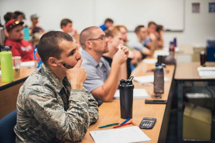 A military member in class on the UCCS campus.