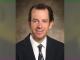 Ben Kwitek with blurred green background