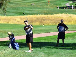 Barrett Jones hits a golf shot.