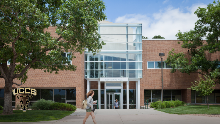 A student walks by the entrance to Centennial Hall