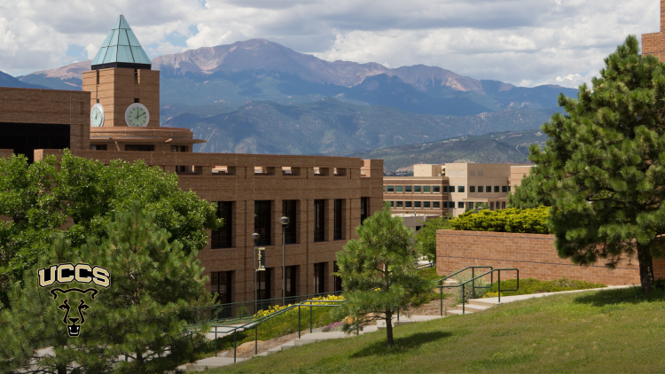 A view of Kraemer Family Library with Pikes Peak in the background in the late spring