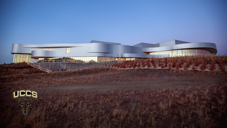 The exterior of the Ent Center for the Arts at dusk
