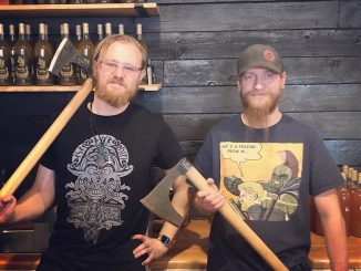 Tim Martin and Mike Sonderby pose with axes in their new restaurant