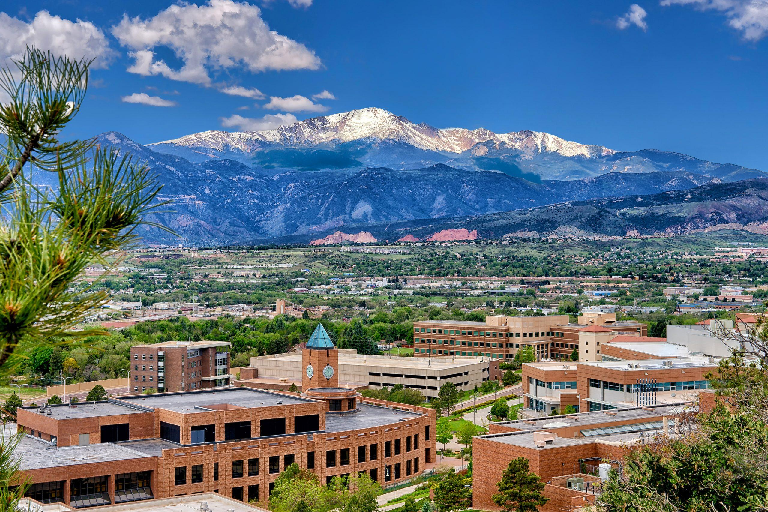 A wide angle of campus with Pikes Peak in the background