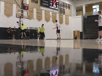 Members of the men's basketball team practice inside Gallogly Events Center