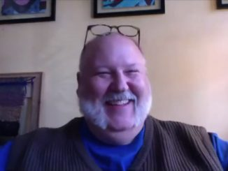 Jay Duckworth smiling during a video interview