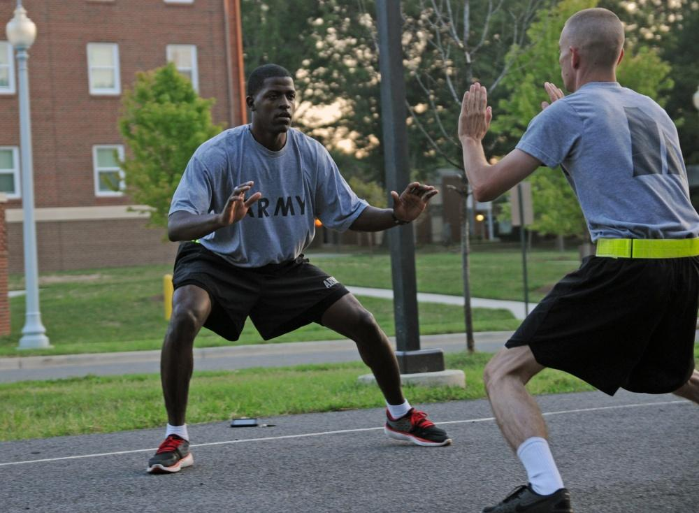 An Army soldier moving laterally outside in gym clothes