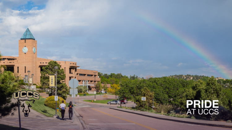 Landscape view of campus with a rainbow over it
