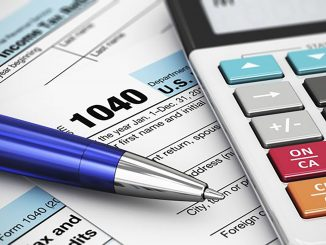 A photo illustration with tax forms, calculator and a pen