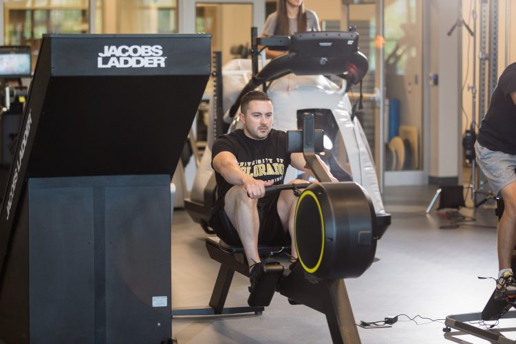 A person using a rowing machine in the Hybl Sports Medicine and Performance Center