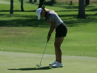 Regina Dillon preparing to put on a golf green