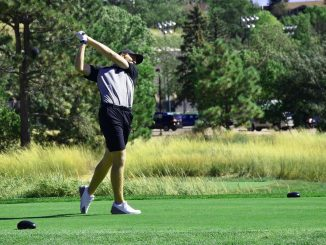 Isaac Spillum hits a drive from the tee