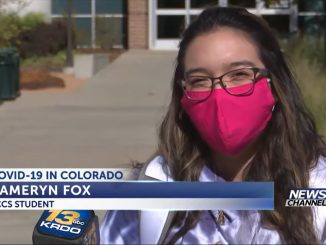 Cameryn Fox wearing a face covering on campus