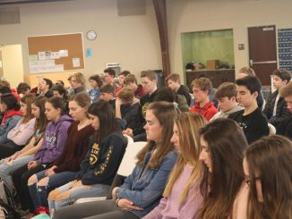 A group of students taking part in a mindfulness exercise