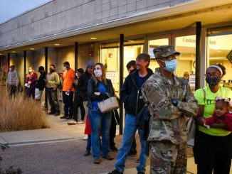 Voters standing outside a library in Fountain, Colorado