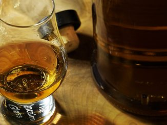 A glass of whiskey on a tablecloth