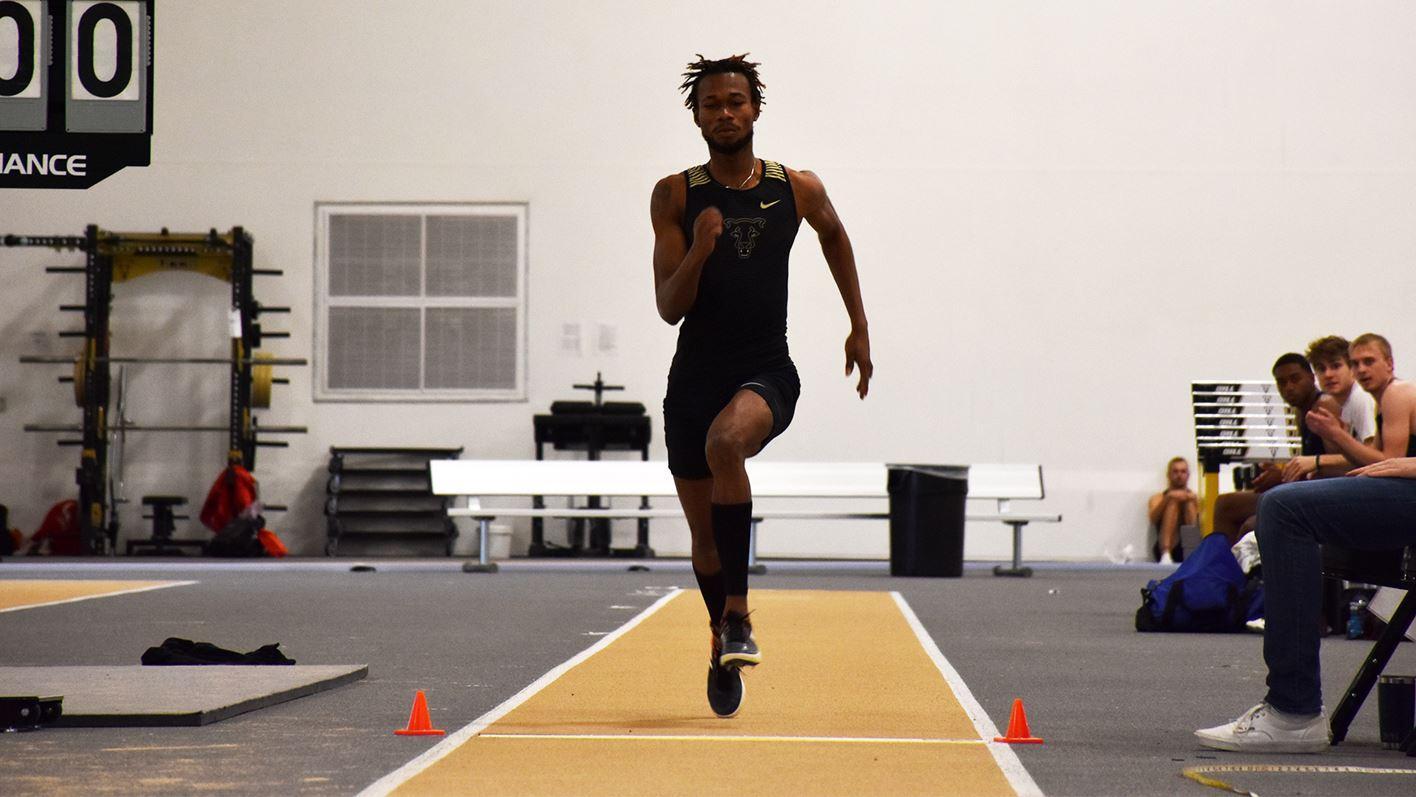 Peter Ackah running down a runway