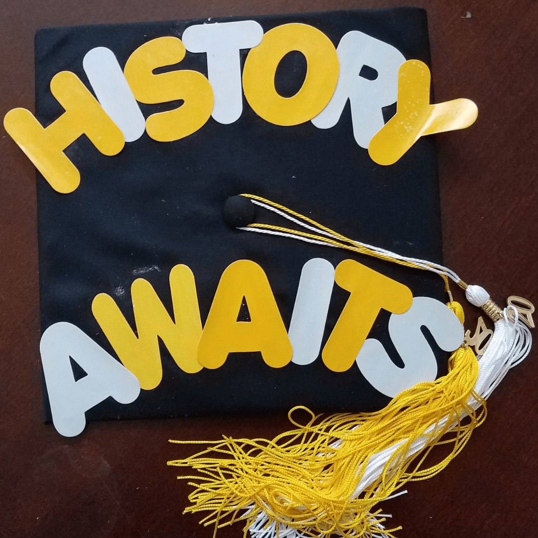Grad cap with the text: History awaits